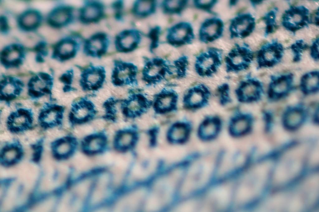 Микрошрифт из надписей 1000 на тысячерублёвой купюре